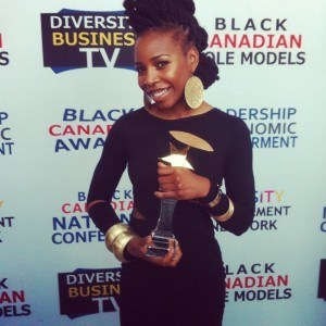 Flo Winning the Black Canadian Music Award for up and coming artist.